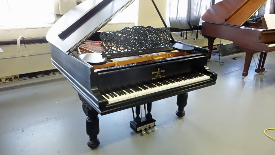 A side photo of a Steinway model A